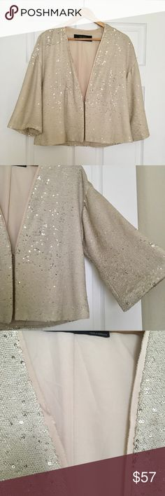 Zara Gold Sequins Kimono Jacket Absolutely my favorite jacket! Size M . No missing sequins no flaws or stains! Great jacket, kind of remind kimono in the design of the sleeves ! Inside pocket (fit for iPhone 6 or ID and cash for a might out) . Great jacket with so much show! Zara Jackets & Coats