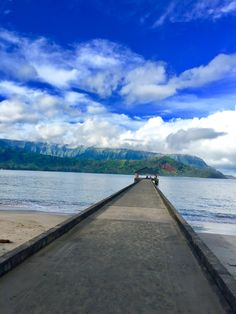 Hanalei Bay, Kaua'i Hawai'i.  You can walk right out on the pier, fish and swim right off of the pier as well.  The water is normally pretty calm unless its mid winter. Waioli Beach Park is the actual Google destination you type in to find it!  Great surrounding food and shopping nearby.https://freeasmetravel.blogspot.com/