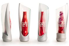 InReality designed a new bottle 'glorifier' for the Coca-Cola aluminum contour bottle lineup (Coca-Cola®, Diet Coke®, Sprite® and Coke Zero®). The goal was to elevate awareness of the product within the often visually crowded space of upscale nightclubs and bars and to create something with as much standalone visual appeal as the bottle itself.