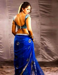 This gorgeous actress loves to flaunt her back!   PIX: Anushka Shetty brings SEXY back!