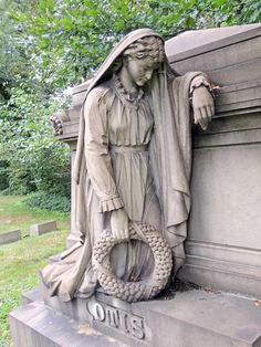 Grieving woman grave marker, Lake View Cemetery, Cleveland, Ohio.