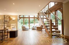 Oak staircase and open plan living area framed by an oak glazed extension. House Staircase, Curved Staircase, Staircase Design, Stairs, Staircases, Cottage Extension, Oak Frame House, Self Build Houses, Timber Frame Homes
