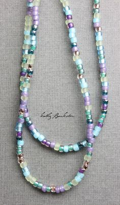 "Multicolor blue purple, gold and teal glass seed bead necklace. All the colors of a summer garden! Very pretty mixture of beads. This listing is for a single 35"" or 39""strand glass seed bead necklace.                                                                                                                                                      More"
