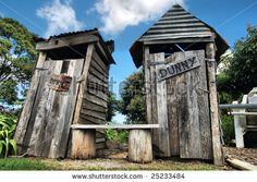 stock photo : Classic country outhouse toilets with waiting area provided