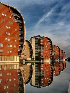 Netherlands, familial, repetitive architecture whose effect is only added to by the reflection in the waters surface