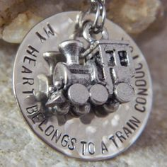 My Heart Belongs to a Train Conductor Handstamped by WireNWhimsy, $32.00 I totally want this too bad my birthday is tomorrow lol