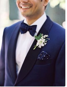 Love the polka dot pocket square with the bow tie