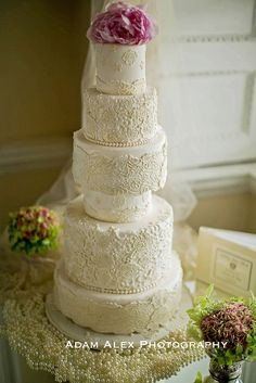 6 tier lace wedding cake ~ The pink peony topper gives the cake a nice pop of colour.  by Elizabeth's Cake Emporium   ᘡղbᘠ