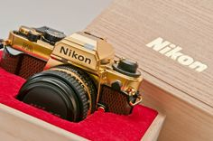 The golden Nikon FA - first golden camera made for public sales, commemorating the victory in the 1984 Camera GP. Shipped with a matching golden Nikkor lens. An amazing film camera, even in todays standards. Nature Photography Tips, Nikon Photography, Photography Classes, Camera Nikon, Camera Gear, Film Camera, Vintage Cameras, Photography Equipment, Taking Pictures