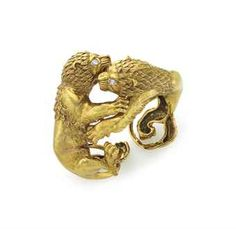 A GOLD AND DIAMOND LION CUFF BRACELET, BY DAVID WEBB