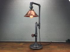 This lamp is a truly unique lighting solution with many applications. A rotating faucet handle serves as a switch to turn the light on and off, a new feature we