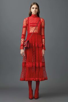 Highly architectural, incorporating the essence of a strong pioneer woman with a delicate English allusion to the soft skin of a woman, visible through lace. (Valentino Resort 2017 Fashion Show)