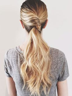 This twisted pony is a beautiful way to keep your hair out of your face this Summer.