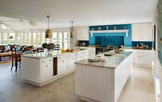 Gold island lighting is unusual...not sure about the mantle idea, but smallbone is a great kitchen company