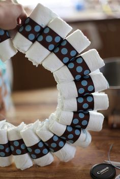 DIY baby shower wreath. Very cute, and cheaper and less work that a while diaper cake! You could add another row/layer of diapers if you wanted to. @Anna Totten Totten Bristle