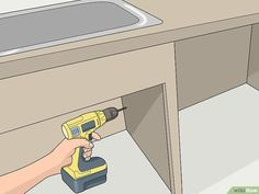 How to Install a Built In Dishwasher. A built-in dishwasher is made to fit seamlessly beneath your kitchen countertop and between your lower cabinets. Installing one is a manageable DIY job, but you'll need to carefully make the needed. Built In Dishwasher, Low Cabinet, Water Supply, Kitchen Countertops, Building, Hands, Buildings, Construction, Architectural Engineering