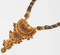 Mangalsutra is worn by a North, western or Cental Indian married woman and the pattern is usually chosen according to the customs of the groom's family. Gold Mangalsutra Designs, Gold Jewellery Design, Antique Jewellery, Lord, Beaded Jewelry, Gold Jewelry, Gold Necklace, Jewellery Sketches, India Jewelry