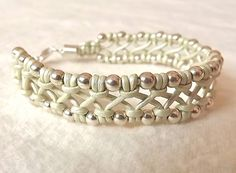 Leather macrame bracelet with sterling silver beads Pale green criss-cross. $73.00, via Etsy.