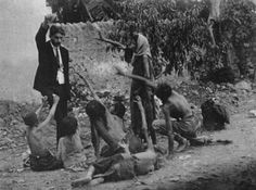 Armenian genocide in 1915. Turkish officials teasing starving Armenian children with bread.