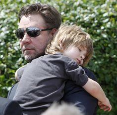 Russell Crowe and his son. Nothin sexier than a man holdin his sleepin boy.