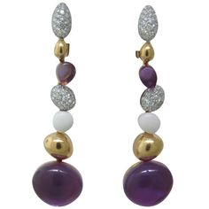 Beautiful 18k rose gold drop earrings by Roberto Coin, featuring diamonds,amethyst cabochon and white gemstone. Earrings are 53mm long and 14mm at widest point. Marked with signature ruby,18Kt and Italy. 21st Century