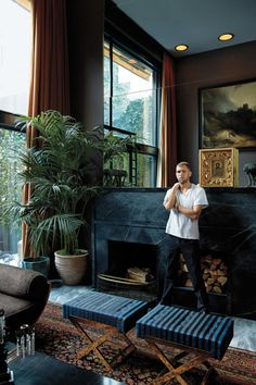 Filmmaker James Oakley stands in the living room of his West Village townhouse | via @natmarchbanks