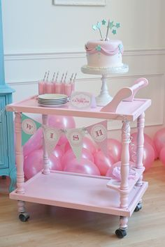 A little paint on a thrift store tea cart makes it into a fantastic and feminine server for birthday cake!