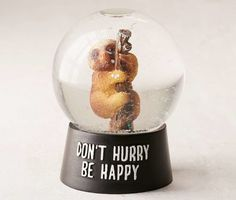Decorate your desk with a glittery sloth snow globe who'll help you ~hang~ in there. | 29 Things For Anyone Who's Feeling Stressed