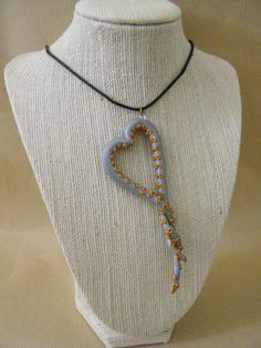 Octopus Tentacle Heart Necklace by thelocalmermaid on Etsy, $15.00