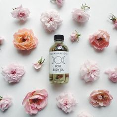 the original rose body oil along with some of our garden roses which will be going into the next batch of flowers & sage sacred smoke incense