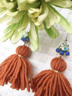 Handmade wool tassels earrings in rust color, handmade in Italy.