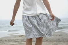 simple summer outfit. love the fabric and style of the skirt. blue and white stripes.