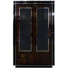 A 1970 elegant display cabinet. Black lacquer surrounds the front veneered in a marquetry of two-tone burl walnut with glass panels enhanced by the nickel frame.Two glass shelves inside and four drawers underneath. Wine Cabinets, Storage Cabinets, Tall Cabinet Storage, Locker Storage, Display Cabinets, Italian Chandelier, Modern Chandelier, Modern Georgian, Mario