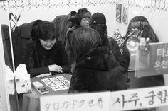 Fortune teller, Seoul  by Tom Spender
