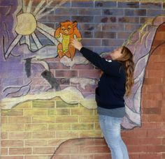 For our last project of the 15/16 school year, we decided to create some interactive murals for the courtyard. First we created our designs on paper . Next, we moved into the courtyard to fill in...