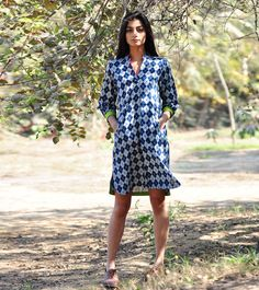 Crated in block printed cotton fabric, our indigo shift dress is all about comfort and style. Basic design with classic detailing makes this design a staple piece. Rani pink and lime green detailing can been seen all along the hemline and front pockets.
