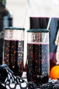 Halloween Witches Brew Black Sangria - Deep, dark witches brew sangria perfect for any Halloween get together! From aberdeenskitchen.com #halloween #sangria #black #witches #brew #wine #drink #beverage #happyhour