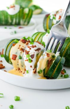 Your zucchini dreams have come true: Loaded Hasselback Zucchini! This tasty foil-baked gluten-free side dish is sure to impress and SO easy to make!