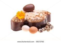 Sold: Traditional Italian desserts for Easter - Easter dove decorated with raw chicken and quail eggs, with a chocolate egg on the top, isolated on white background. by eZeePics Studio, via ShutterStock