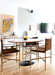 Modern dining space with leather chairs