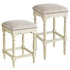 With classic turned legs, carved apron, plush linen seat and brass nailhead trim, the French-inspired Ellie brings vintage-style elegance to your counter or bar. Sturdy box stretcher fortifies the solid hardwood frame.
