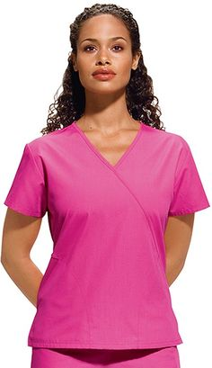 Style Code: (CH-4880)  A fit and flare mini mock wrap top that has two side angled, topstitched pockets and side vents.