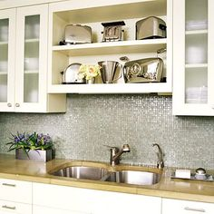 I should definitely consider the space above my sink, between my cabinets, for some additional storage!