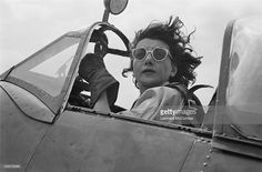 A ferry pilot of the ATA (Air Transport Auxiliary) in the cockpit of a Supermarine Spitfire fighter, September 1944. ATA pilots deliver newly manufactured aircraft from the factory to military airfields. Original publication: Picture Post - 1805 - The Work Of The Ferry Pilots - pub. 16th September 1944.