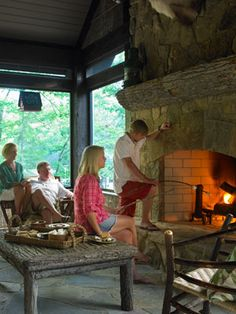 Enclosed Porch With Fireplace    This summer cabin, off Georgia's Lake Burton, boasts an enclosed porch with a large stone fireplace, perfect for gathering around on chilly early summer evenings.    Read more: Porch and Patio Decorating Ideas - Outdoor Room Ideas - Country Living
