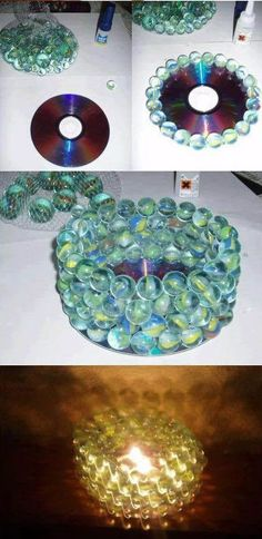 Marbles and an old CD can make for a beautiful and reflective candle holder