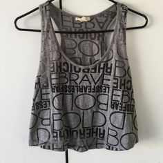 Forever21 top This gray top looks super nice with shorts and sunglasses! It is see through, and I have worn it a couple times, but it still looks super cute! Comment if you have any questions! Forever 21 Tops Crop Tops