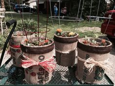 Vegetable planters using 5 gallon buckets covered in burlap and rafia
