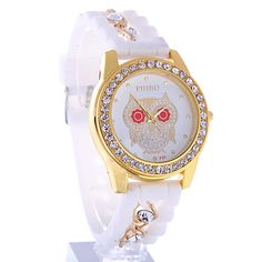 Relogio Feminino Luxury Women Dress Watch - Designer inspired dress watch with crystal accents. - Delicately feminine owl design - This inspired style band features beautiful metal tone finishes, with