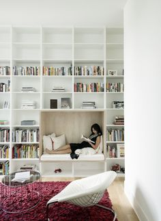 A cozy reading nook in a spacious home library. A cozy reading nook in a spacious home library.